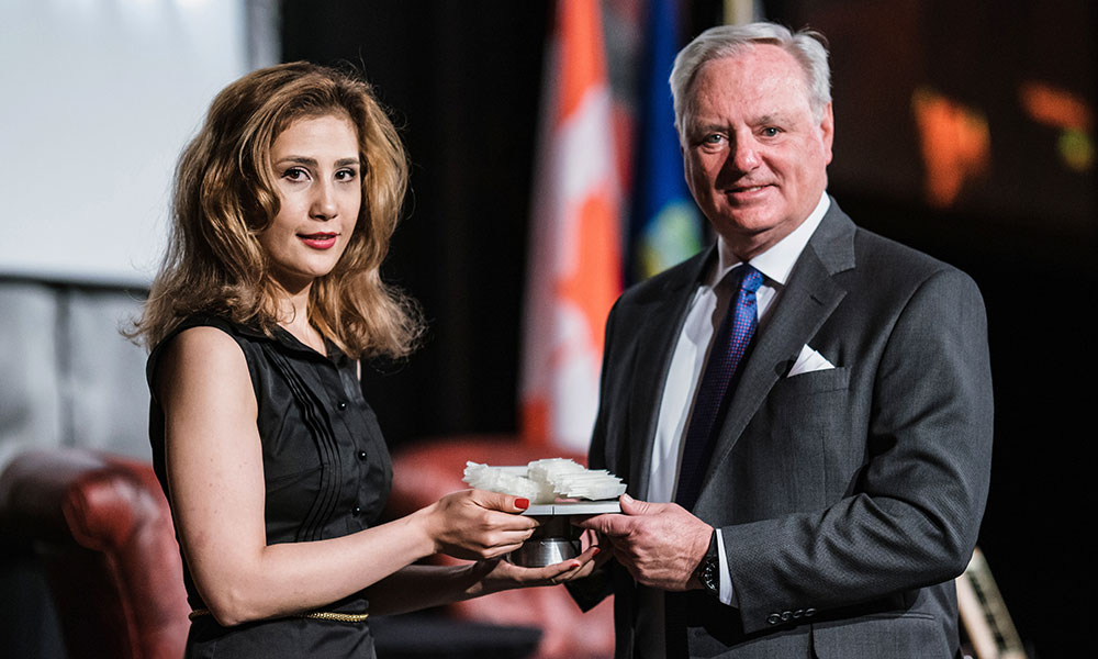 Bavi receiving the University of Calgary's Distinguished Artist Award and Scholarship in 2019