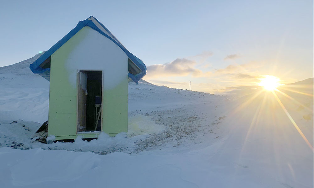 Sun setting on a makeshift survival shelter at 7,000ft near the Andrei Icefield in northwestern British Columbia.